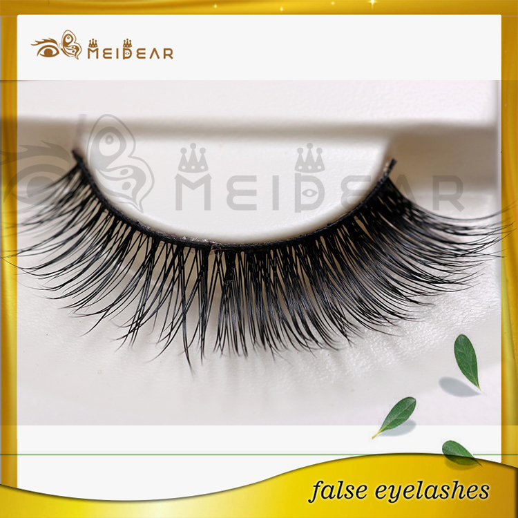 Putting on false eyelashes for make up